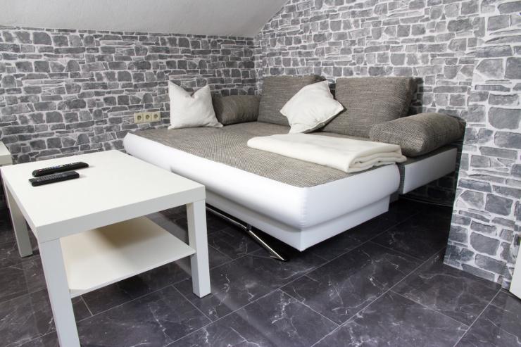 Schöne Polstermöbel verschönern den Raum. (Bild: © thombach - Fotolia.com)